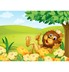 A lion with a crown near a tree in the hill vector image