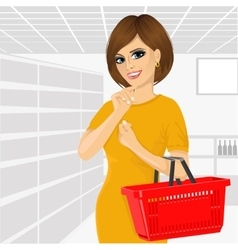 Thoughtful woman holding an empty shopping basket vector