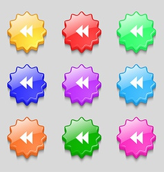 Rewind icon sign symbol on nine wavy colourful vector