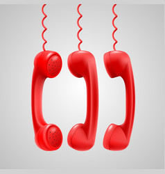 Hanging red handsets vector