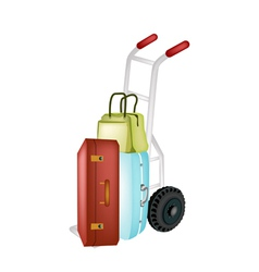 Hand truck loading stack of luggages and bag vector