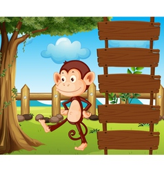 A monkey beside a wooden signage vector image