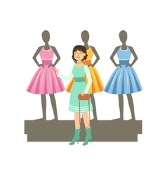 Woman choosing dresses on mannequinns in shopping vector