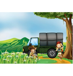A girl and a boy beside the green truck vector image vector image