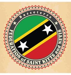 Vintage label cards of saint kitts and nevis flag vector