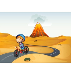 A boy riding a bike in the desert vector image