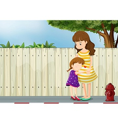 A mother and her daughter near the fence at the vector image