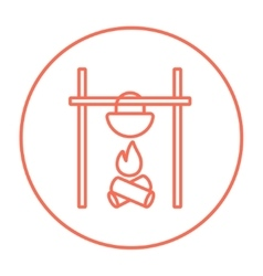 Cooking in cauldron on campfire line icon vector