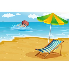A boy swimming at the beach with a chair and an vector