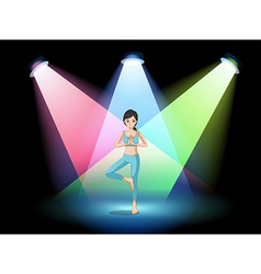 A girl doing yoga in the middle of the stage vector