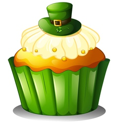A cupcake with a green hat vector