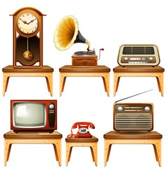 Retro antiques on wooden table vector
