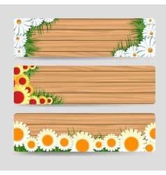 Wood banners with grass and flowers vector