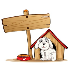 A dog inside the dog house with a wooden signboard vector image vector image