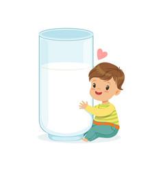 Cute little boy hugging giant milk glass healthy vector