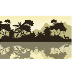 Silhouette of jungle with mountain background vector