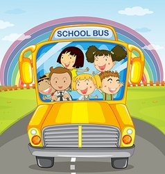 Children riding in the school bus vector