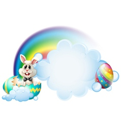 A cracked egg with a bunny near the rainbow vector image