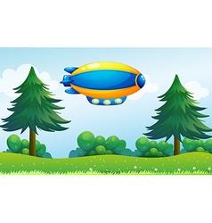 An airship near the hilltop vector