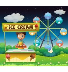 A boy with an icecream stall near the ferris wheel vector image vector image