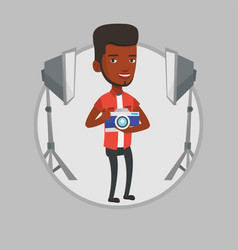 photographer with camera in photo studio vector image