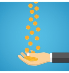 Gold coins fall into the hand vector image
