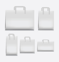 Paper shopping bag white various sizes vector