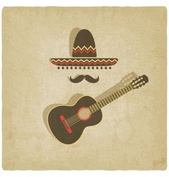 Mexican sombrero and guitar old background vector image