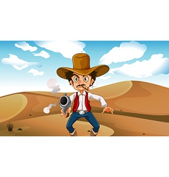 A cowboy smoking with a gun at the desert vector image vector image