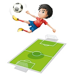 A boy kicking the ball vector image vector image
