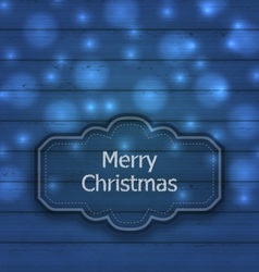 Christmas label on wooden texture with light - vector