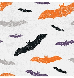 Seamless halloween grunge pattern with bats vector