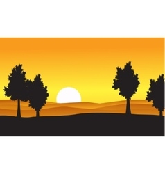 Silhouette of tree on the hill at the sunset vector