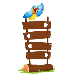A parrot at the top of the signboards with arrows vector image