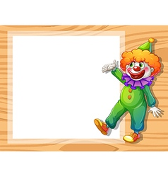 A clown beside an empty white board vector image