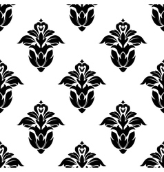 Seamless pattern of floral motifs vector