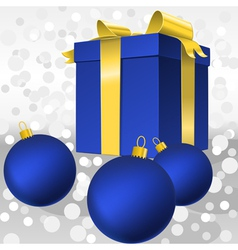 christmas blue gift box with gold ribbon and balls vector image