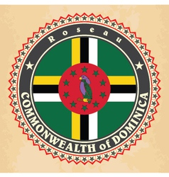 Vintage label cards of dominica flag vector