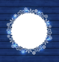 Christmas round frame made in snowflakes on blue vector