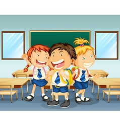 Three children smiling inside the classroom vector image