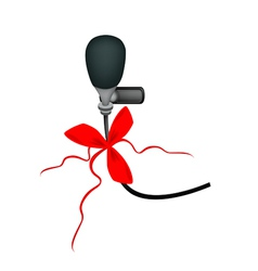 A black wireless microphone with red ribbon vector