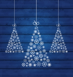 Holiday wooden background with christmas pines vector