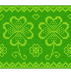 Patricks day green knitted sweater with clover vector image