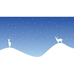 Silhouette of reindeer on hill scenery vector