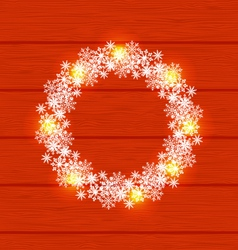 Christmas circle frame made in snowflakes on red vector image vector image