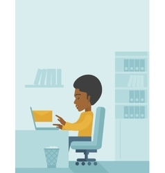 Young african man sitting infront of a computer vector