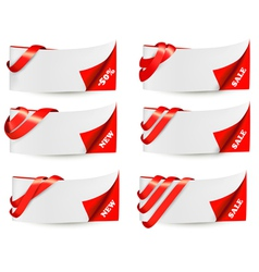Red sale banners with red ribbons vector