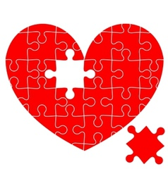Jigsaw puzzle in the red heart vector image