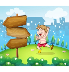 A young boy playing beside the wooden arrowboard vector image vector image