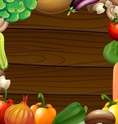 Vegetables border on wooden frame vector